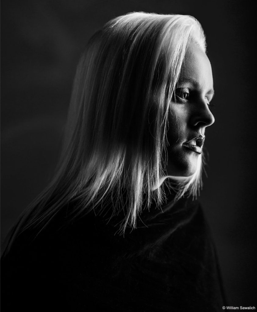Low key bw portrait lighting black and white photography