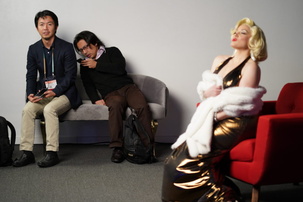 Sony staffers taking a break while a model poses.